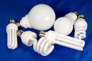 six energy saving fluorescent lamps on blue background