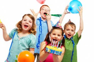 Children with birthday cake and balloons